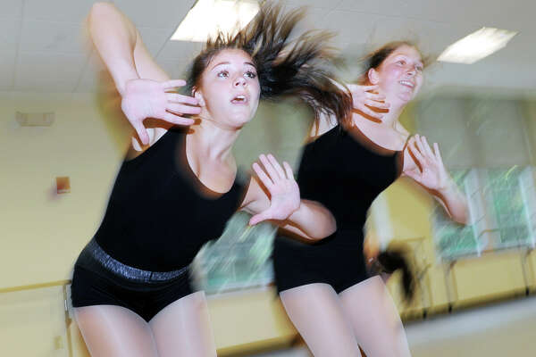 Kiersten Yusi, 13, left, and Caroline Sweeney, 16, work on a dance routine at the Western Greenwich Civic Center in the Glenville section of Greenwich, Conn., Wednesday, June 29, 2016. Both girls are a part of the Greenwich dance troupe, Ambassadors in Leotards, who will be traveling to and performiing in Germany in early July as goodwill dance ambassadors to raise money for a school there that serves the special education needs of German children.