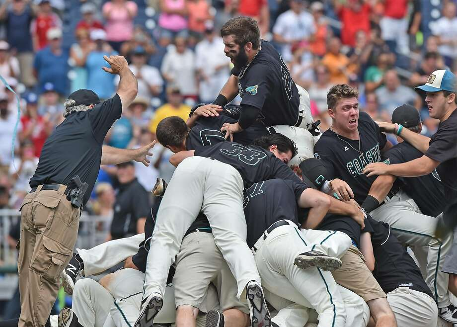 Coastal Carolina enjoys the traditional dogpile as the Chanticleers wrapped up its first national championship in any sport Thursday. Photo: Peter Aiken, Getty Images