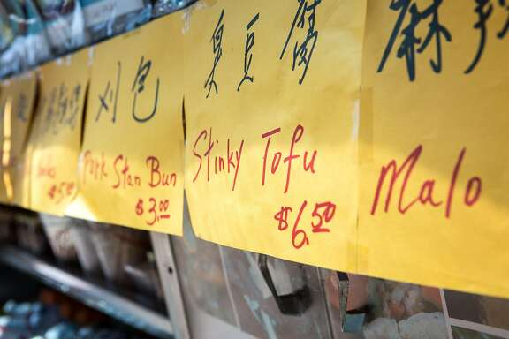 Handwritten signs are displayed on Mama Liu's food truck at the Taiwanese Night Market in Sunnyvale, Calif. on Sunday, June 26, 2016.