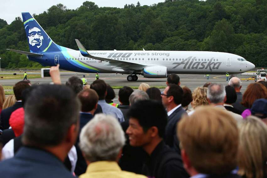 A new Alaska Airlines 737 painted with a Boeing centennial theme arrives during a kickoff celebration for Boeing's 100th anniversary month, Thursday, June 30, 2016 at the Museum of Flight.