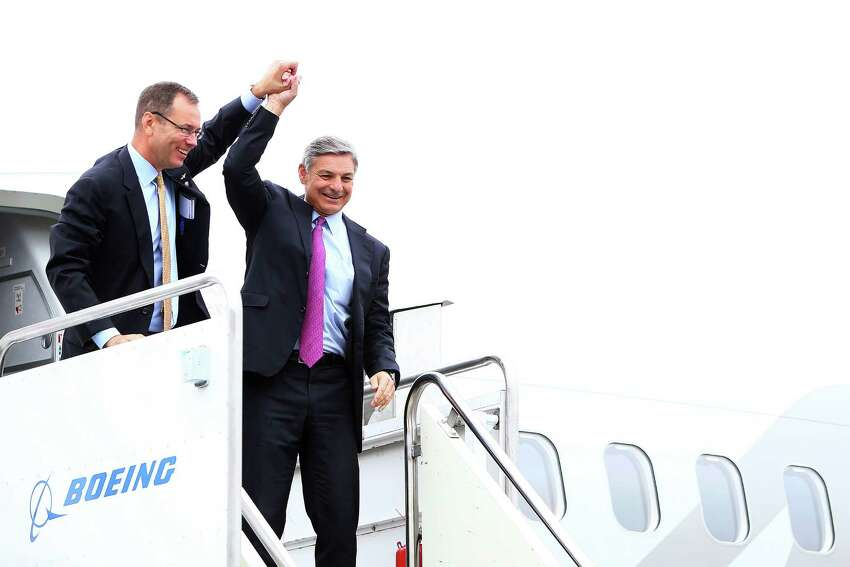 Alaska Airlines CEO Bradley Tilden, left, and Boeing CEO Ray Conner arrive on a new Alaska Airlines 737 painted with a Boeing centennial theme during a kickoff celebration for Boeing's 100th anniversary month, Thursday, June 30, 2016 at the Museum of Flight.