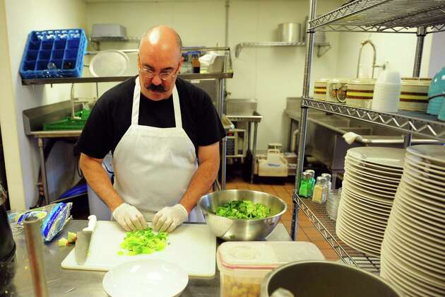Owner John Spinetti works in the kitchen at Rosa Mina's, an new Italian restaurant located on East Main Street in Ansonia, Conn. on Thursday June 23, 2016. New restaurants in the city are beginning to transform downtown.