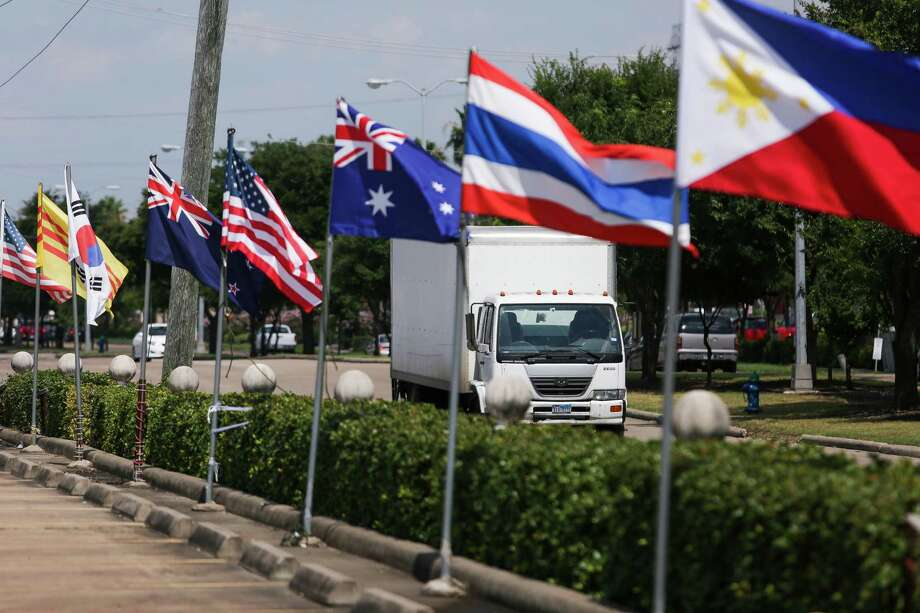 Flags from multiple countries fly alongside Bellaire Boulevard between Turtlewood Drive and Cook Road, an area some want to call Little Saigon, Thursday, June 30, 2016 in Houston. Photo: Michael Ciaglo, Houston Chronicle / © 2016  Houston Chronicle