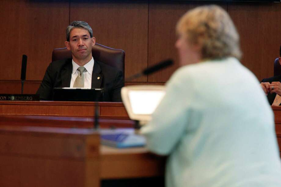 District 8 City Councilman Ron Nirenberg listens as scientist Anne LeHuray makes a case against a proposed ban on the use of coal-tar-based sealing products. Photo: Jerry Lara / San Antonio Express-News / © 2016 San Antonio Express-News
