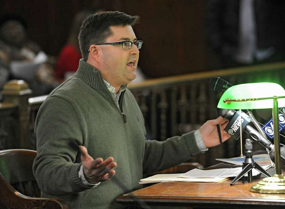 Albany County Legislator Chris Higgins of Albany explains the trash tax is bad for business before the Albany Common Council at City Hall on Monday, March 21, 2016 in Albany, N.Y. There is to be a vote to repeal the Albany trash fee. (Lori Van Buren / Times Union) Photo: Lori Van Buren / 10035900A