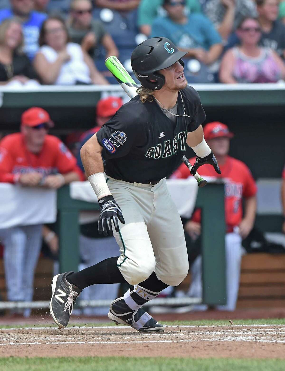 Omaha, NE - JUNE 30: Third basemen Zach Remillard #6 of the Coastal Carolina Chanticleers drives in two runs on a two run error by the Arizona Wildcats in the sixth inning during game three of the College World Series Championship Series on June 30, 2016 at TD Ameritrade Park in Omaha, Nebraska. (Photo by Peter Aiken/Getty Images) ORG XMIT: 651319573