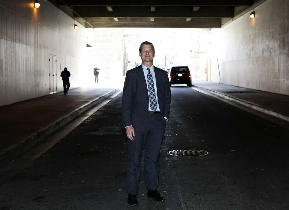 Trent Rhorer, executive director of the Human Services Agency, stands on a street in San Francisco. Photo: Connor Radnovich, The Chronicle