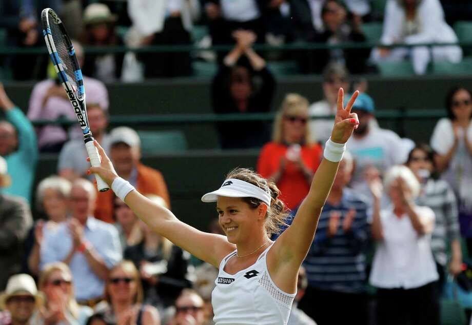 Jana Cepelova of Slovakia celebrates after beating Garbine Muguruza of Spain in their women's singles match on day four of the Wimbledon Tennis Championships in London, Thursday, June 30, 2016. (AP Photo/Ben Curtis) Photo: Ben Curtis, STF / Copyright 2016 The Associated Press. All rights reserved. This material may not be published, broadcast, rewritten or redistribu