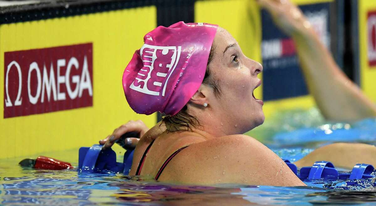 Cammile Adams reacts after winning the women's 200-meter butterfly final at the U.S. Olympic swimming trials, Thursday, June 30, 2016, in Omaha, Neb. (AP Photo/Mark J. Terrill)