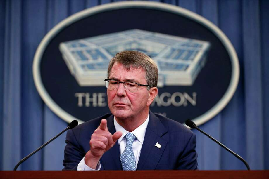 Defense Secretary Ash Carter points to a questioner during a news conference at the Pentagon, Thursday, June 30, 2016, where he announced new rules allowing transgender individuals to serve openly in the U.S. military. (AP Photo/Alex Brandon) Photo: Alex Brandon, STF / Associated Press / Copyright 2016 The Associated Press. All rights reserved. This material may not be published, broadcast, rewritten or redistribu
