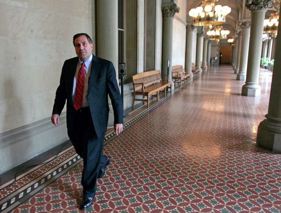 FILE - In this June 10, 2009 file photo, Steven Pigeon walks in a hallway at the Capitol in Albany, N.Y. The Democratic political operative from Buffalo has been charged as part of a corruption probe that has led to the resignation of a judge. Pigeon was charged Thursday morning, June 30, 2016, with bribery, rewarding official misconduct and grand larceny. He pleaded not guilty to the charges. Pigeon was expected to post the bail of $10,000 cash or $20,000 bond. (AP Photo/Mike Groll, File) Photo: Mike Groll / AP2009