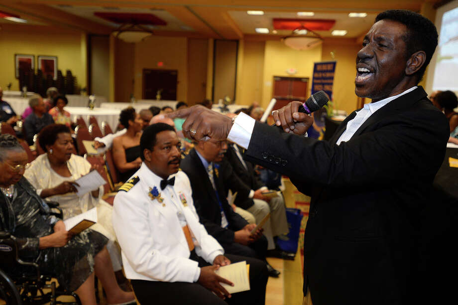 Robert Cummings, class of 1968, sings during the opening ceremony for the Hebert High School Mass Reunion on Thursday evening. The school's graduates hold a reunion every three years.  Photo taken Thursday 6/30/16 Ryan Pelham/The Enterprise Photo: Ryan Pelham / ©2016 The Beaumont Enterprise/Ryan Pelham
