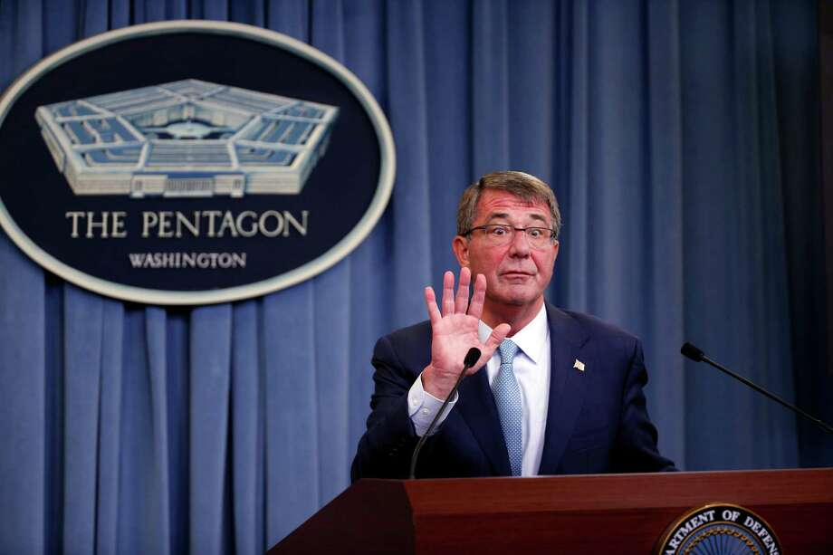Defense Secretary Ash Carter reacts to a reporter's attempt at one last question as he departs a news conference at the Pentagon Thursday. Photo: Alex Brandon, STF / Copyright 2016 The Associated Press. All rights reserved. This material may not be published, broadcast, rewritten or redistribu