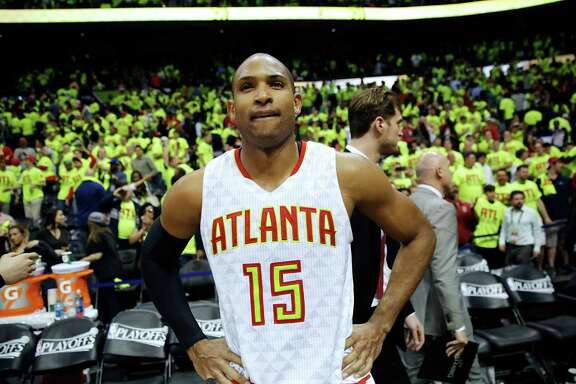 Atlanta Hawks' Al Horford stands on the court after the Hawks beat the Boston Celtics 102-101 in Game 1 of a first-round NBA basketball playoff series Saturday, April 16, 2016, in Atlanta. (AP Photo/David Goldman)
