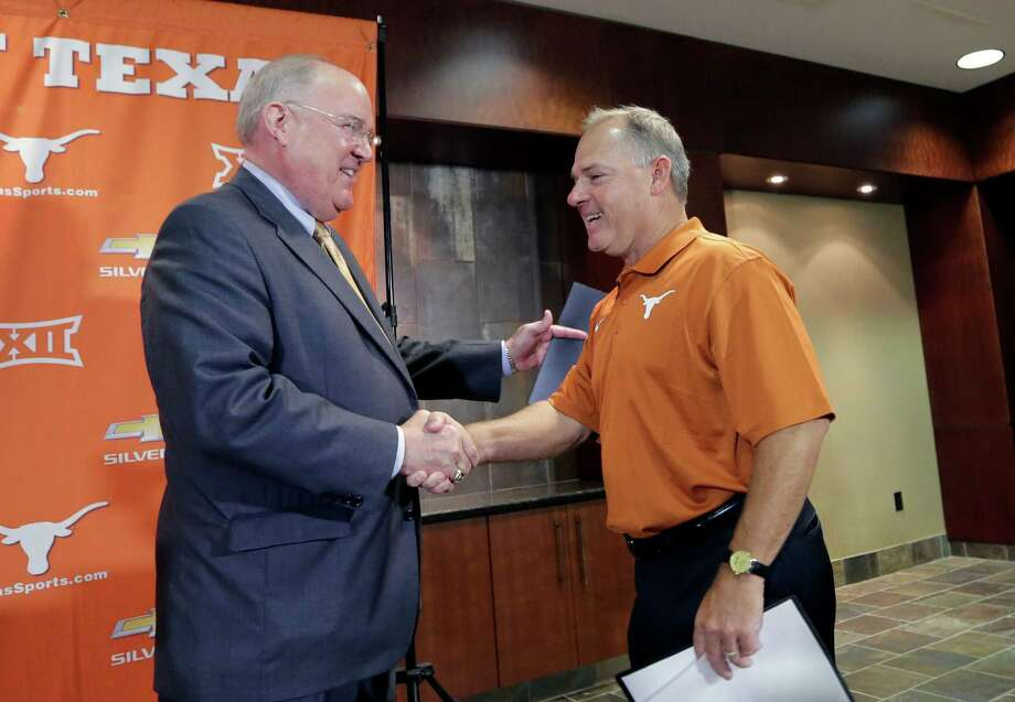 """Texas athletic director Mike Perrin, left, labeled David Pierce as a """"proven commodity"""" in welcoming him to the Longhorns family Thursday. Photo: Eric Gay, STF / AP"""