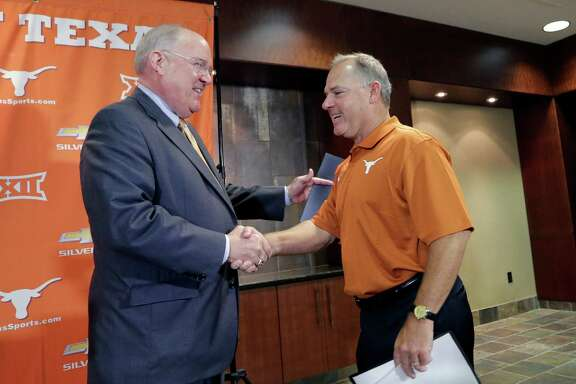 """Texas athletic director Mike Perrin, left, labeled David Pierce as a """"proven commodity"""" in welcoming him to the Longhorns family Thursday."""