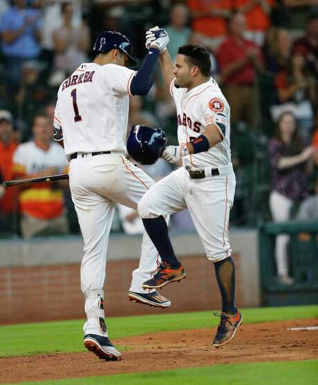 Astros second baseman Jose Altuve, right, did considerable celebrating with Carlos Correa during an 18-8 June in which Altuve batted .420. Photo: Karen Warren, Staff / © 2016 Houston Chronicle