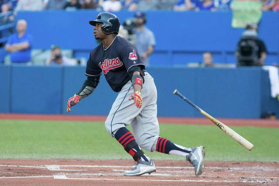 Cleveland Indians' Rajai Davis watches his solo home run off Toronto Blue Jays' starting pitcher R.A. Dickey during the second inning of a baseball game Thursday, June 30, 2016, in Toronto. (Chris Young/The Canadian Press via AP) ORG XMIT: CHY105 Photo: Chris Young / The Canadian Press