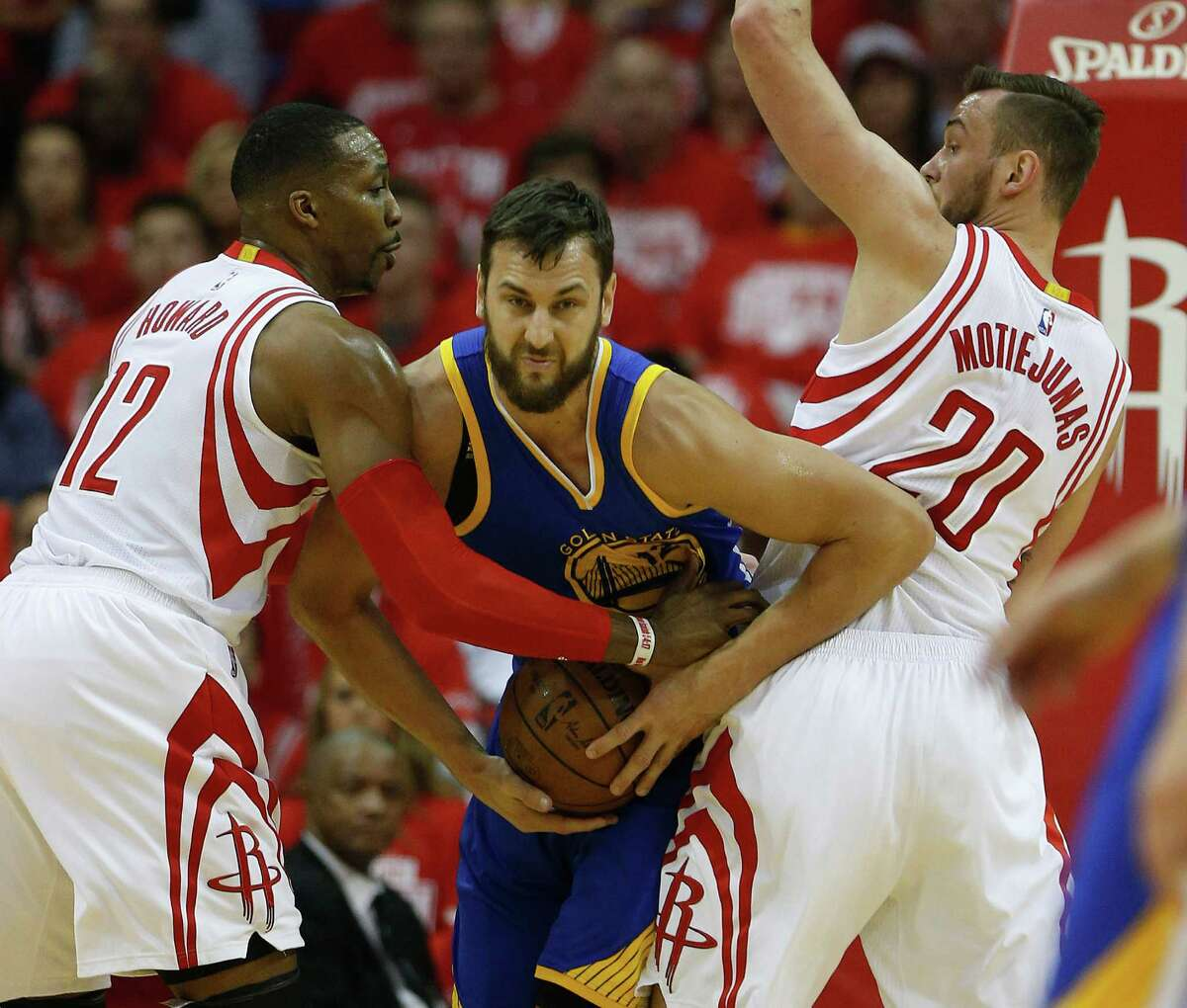 Dwight Howard, left, and Donatas Motiejunas had Warriors center Andrew Bogut sandwiched in the playoffs. But it doesn't look likely Howard will remain a Rockets teammate with Motiejunas next season.