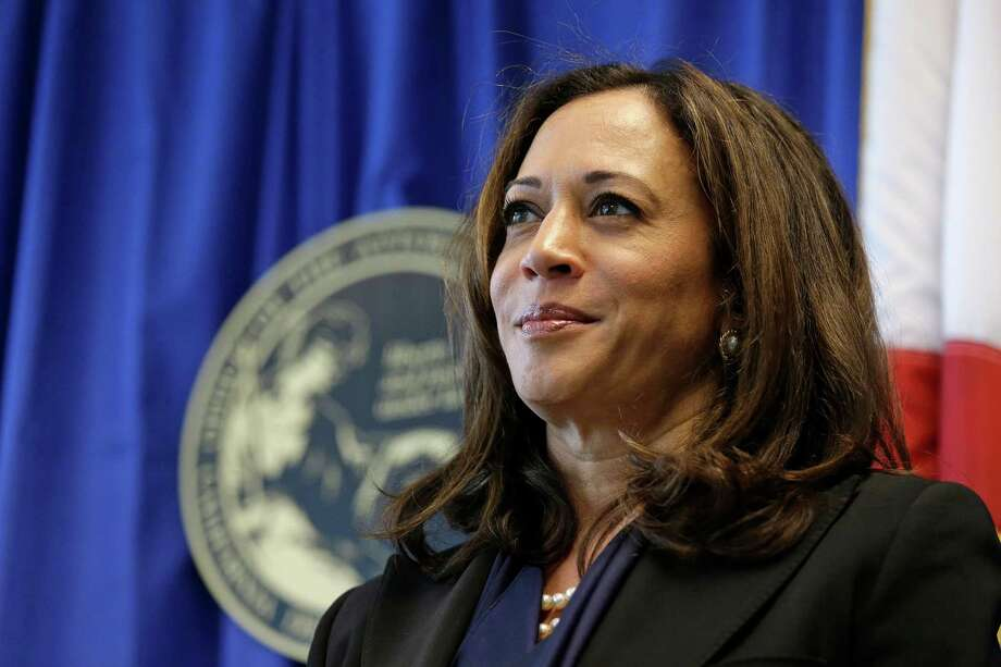 California Attorney General Kamala Harris listens to questions about a settlement with Volkswagen during a news conference Tuesday, June 28, 2016, in San Francisco. Volkswagen will spend up to $15.3 billion to settle consumer lawsuits and government allegations that it cheated on emissions tests in what lawyers are calling the largest auto-related class-action settlement in U.S. history. Up to $10 billion will go to 475,000 VW or Audi diesel owners, who thought they were buying high-performance, environmentally friendly cars but later learned the vehicles' emissions vastly exceeded U.S. pollution laws. (AP Photo/Eric Risberg) Photo: Eric Risberg, STF / AP