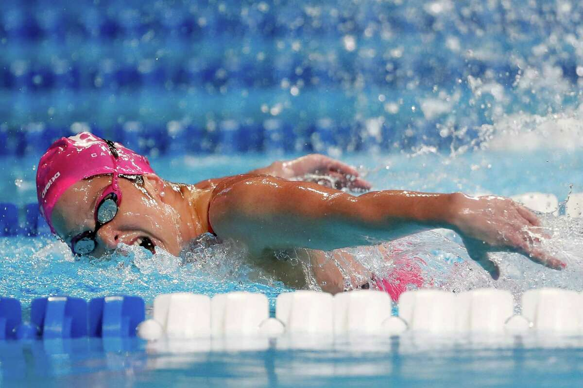 Cypress Woods and Texas A&M product Cammile Adams shows her winning form in the 200-meter butterfly Thursday, repeating as the champion of the event at the U.S. trials and giving her a chance to improve upon a fifth-place finish in London in 2012.