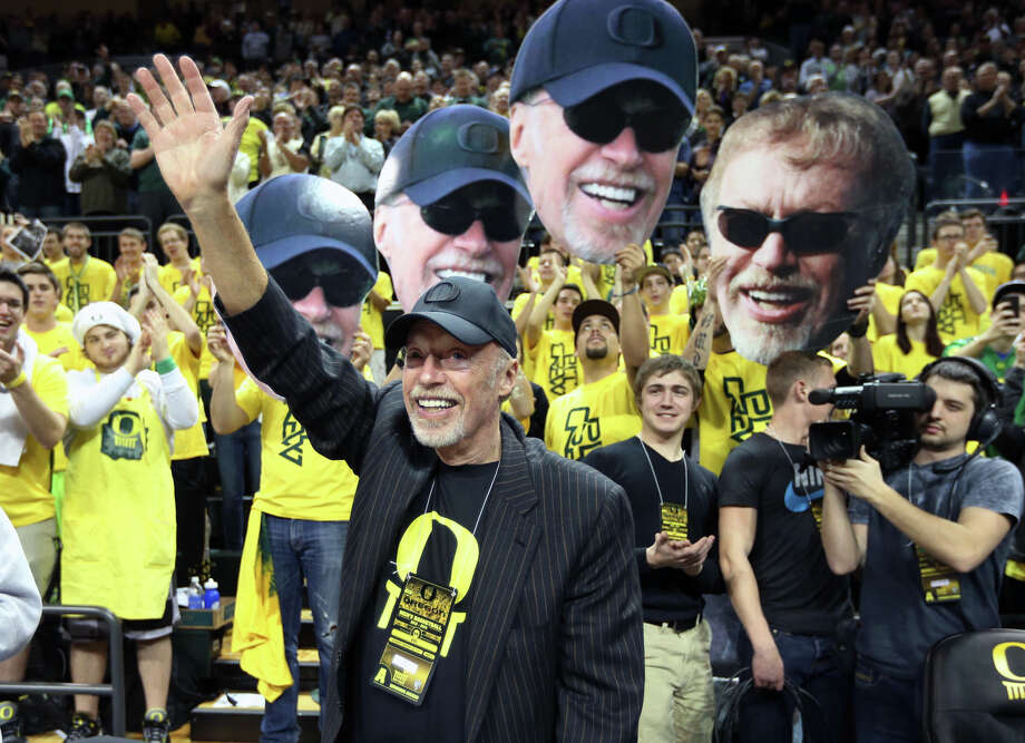 FILE- In this Feb. 1, 2014, file photo, Nike's Phil Knight acknowledges the crowd on Uncle Phil Appreciation Night at Matthew Knight Arena during Oregon's NCAA college basketball game against Southern California in Eugene, Ore. Nike said Thursday, June 30, 2016, that its' co-founder and chairman has retired from its board. (AP Photo/Chris Pietsch, File) Photo: Chris Pietsch, FRE / Copyright 2016 The Associated Press. All rights reserved. This material may not be published, broadcast, rewritten or redistribu