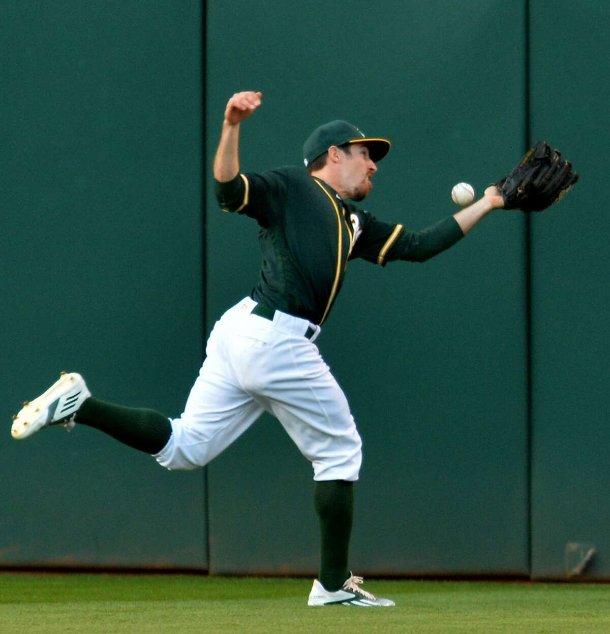Oakland Athletics centerfielder Billy Burns is unable to catch double by the San Francisco Giants' Madison Bumgarner in the third inning at the Coliseum in Oakland, Calif., on Thursday, June 30, 2016. (Doug Duran/Bay Area News Group/TNS)