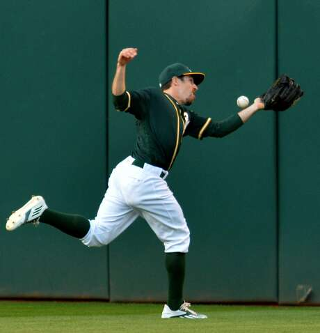 Oakland Athletics centerfielder Billy Burns is unable to catch double by the San Francisco Giants' Madison Bumgarner in the third inning at the Coliseum in Oakland, Calif., on Thursday, June 30, 2016. (Doug Duran/Bay Area News Group/TNS) Photo: Doug Duran, TNS