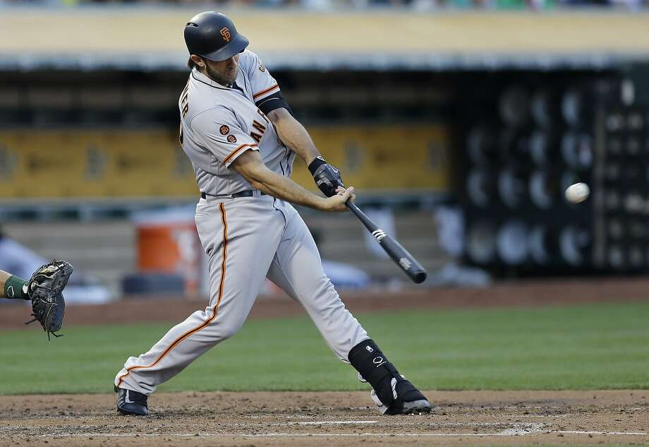 San Francisco Giants' Madison Bumgarner swings for a double off Oakland Athletics' Dillon Overton in the third inning of a baseball game Thursday, June 30, 2016, in Oakland, Calif. (AP Photo/Ben Margot) Photo: Ben Margot, Associated Press