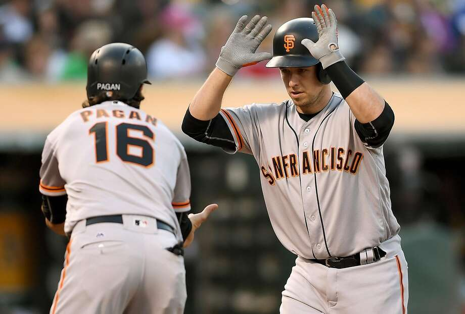 OAKLAND, CA - JUNE 30:  Buster Posey #28 of the San Francisco Giants is congratulated by Angel Pagan #16 after Posey hit three-run homer against the Oakland Athletics in the top of the third inning at O.co Coliseum on June 30, 2016 in Oakland, California.  (Photo by Thearon W. Henderson/Getty Images) Photo: Thearon W. Henderson, Getty Images