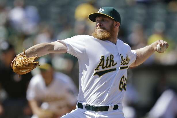 Oakland Athletics' Sean Doolittle works against the Detroit Tigers in the ninth inning of a baseball game Sunday, May 29, 2016, in Oakland, Calif. (AP Photo/Ben Margot)