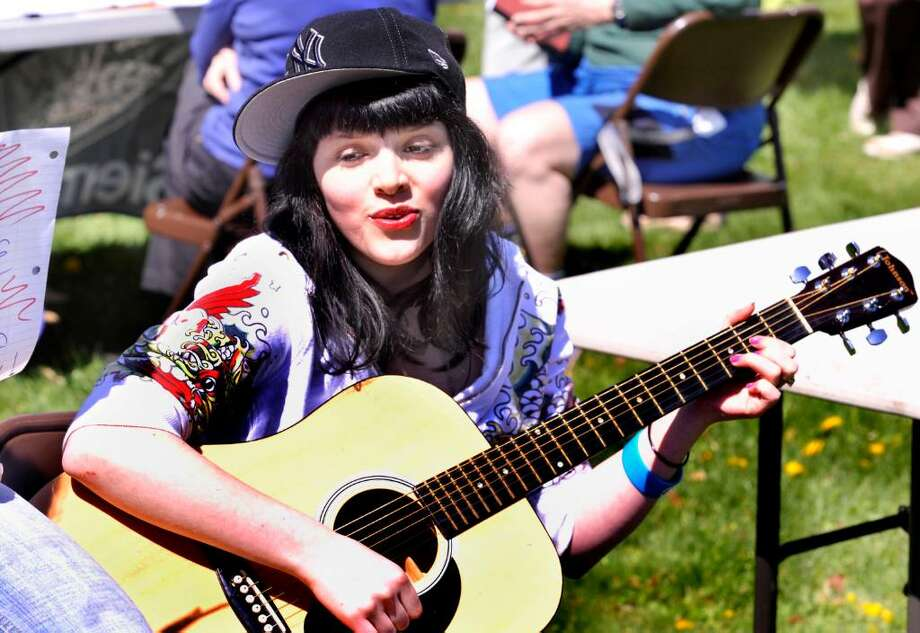Jaxx Winkler, 12, plays guitar and sings in celebration of the third annual Newtown Earth Day Festival on Saturday, April 23, 2010. Photo: Michael Duffy / The News-Times