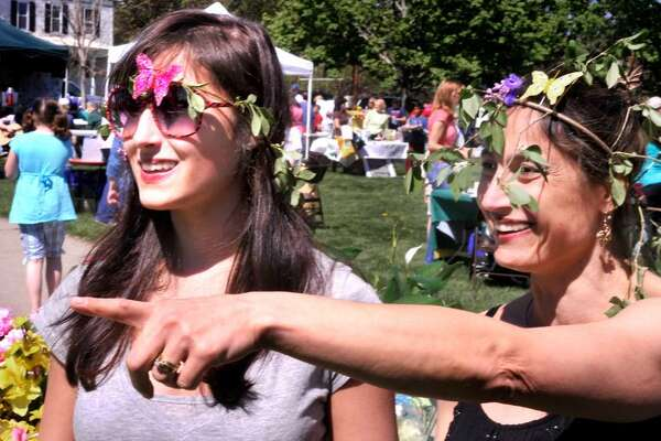 Jetika Zanard, 16, and her mom, Joani Kloth-Zanard, of Southbury, are dressed in the spirit of the day during the third annual Newtown Earth Day Festival, which took place at Newtown Middle School on Saturday, April 23, 2010.