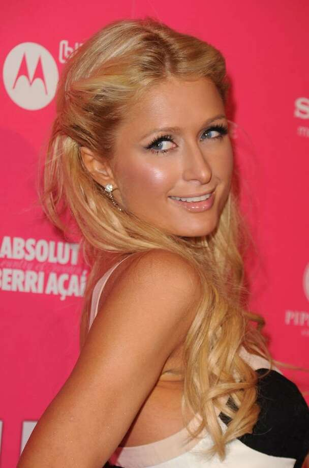 HOLLYWOOD - APRIL 22:  Socialite Paris Hilton arrives at the Us Weekly Hot Hollywood Style Issue celebration held at Drai's Hollywood at the W Hollywood Hotel on April 22, 2010 in Hollywood, California.  (Photo by Jason Merritt/Getty Images) *** Local Caption *** Paris Hilton Photo: Jason Merritt, Getty Images / 2010 Getty Images