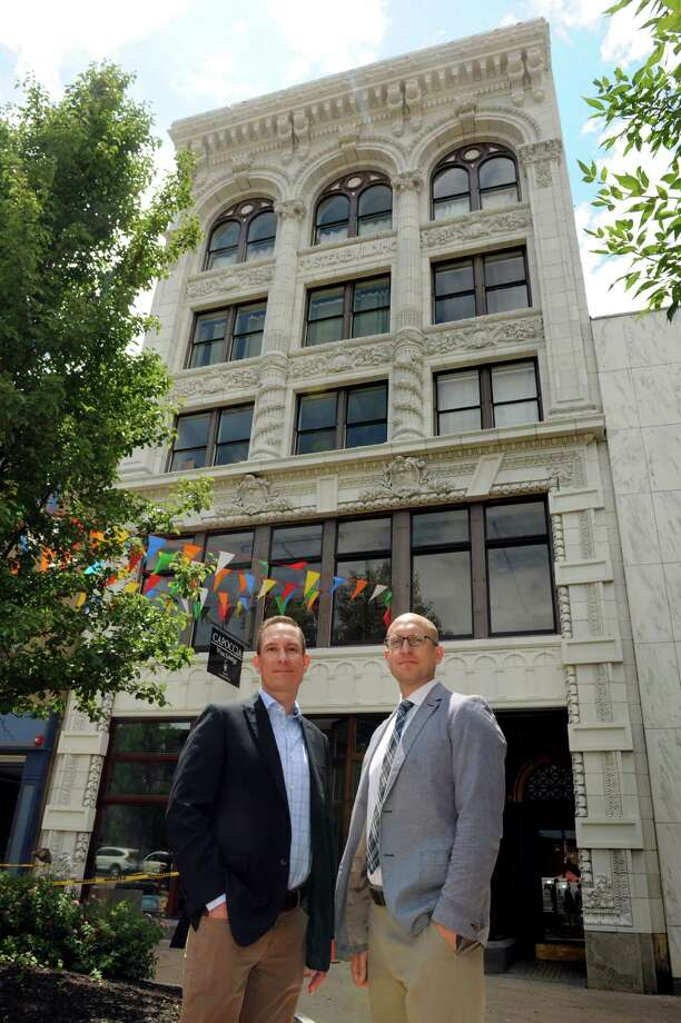 Jim Salengo, executive director of Downtown Schenectady Improvement Corp., left, and Matt Smith, homeownership coordinator for the City of Schenectady, in front of the Foster Building development at 508 State Street on Wednesday, June 29, 2016, in Schenectady, N.Y. (Cindy Schultz / Times Union) Photo: Cindy Schultz / Albany Times Union