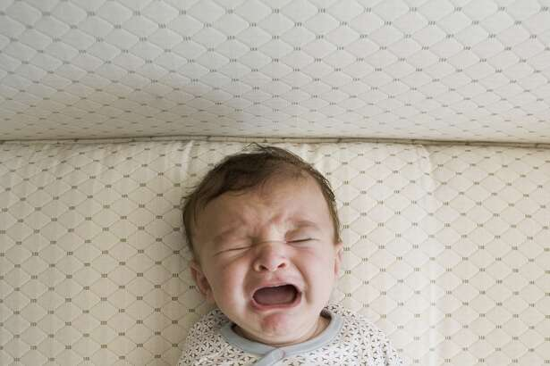 """It may be hard to listen to baby crying, but research shows that babies who """"cry it out"""" to get to sleep go to bed faster and stay asleep longer than other babies."""