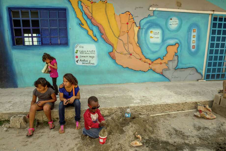 FILE -- Undocumented migrant children play near a map of Mexico at the 72 migrant shelter in Tenosique, Mexico, July 2, 2014. A U.S.-Mexico deportation policy can mean death for youths targeted by the gangs they fled. (Meridith Kohut/The New York Times)  ORG XMIT: XNYT21 Photo: MERIDITH KOHUT / NYTNS