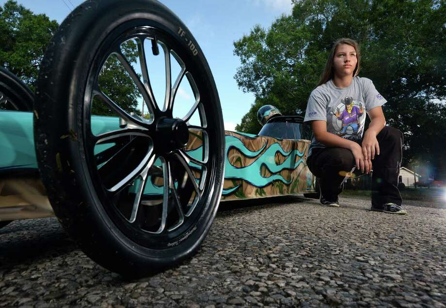 After only four months behind the wheel of her dragster, Kinley Wolfford, 12, of Mauriceville recently won the Western Conference of the National Hotrod Association's junior league.   Photo taken Wednesday, June 29, 2016 Guiseppe Barranco/The Enterprise Photo: Guiseppe Barranco, Photo Editor
