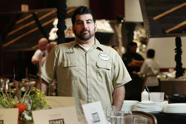Kevin Naderi, of Roost, poses for a photo at Bon Vivant