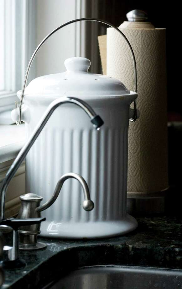 A piece of crockery makes a handy kitchen composter.