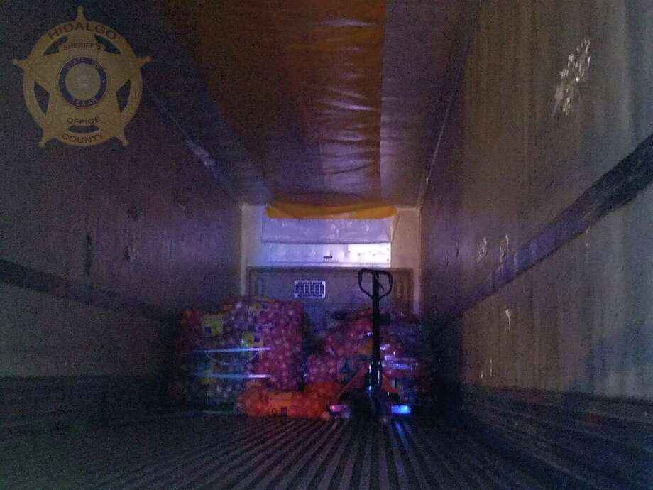On Thursday night, U.S. Border Patrol agents were alerted to 25 undocumented immigrants who were found behind a false door on a tractor trailer in Edinburg, according to theHidalgo County Sheriff's Office. Photo: Courtesy/Hidalgo County Sheriff's Office Facebook