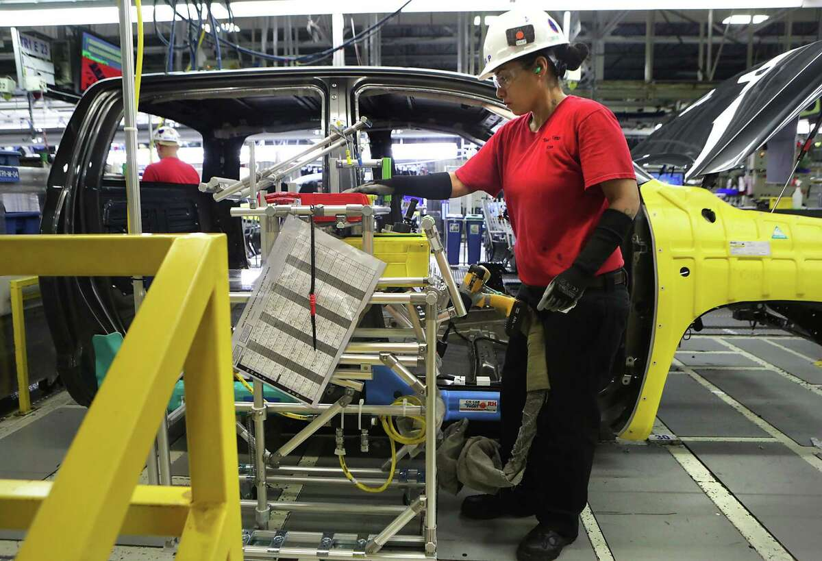 An employee works on a Tacoma pickup cab at the Toyota Motor Manufacturing Texas plant in San Antonio. Texas manufacturers are more optimistic after the election of Donald Trump.