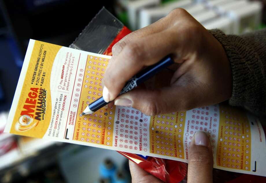 San Antonio woman claims million dollar prize from lottery ticket bought at an area H-E-B. Photo: Nam Y. Huh/Associated Press