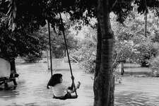 1954: Little girl swinging about flood waters in the Rio Grande Valley.  (Photo by John Dominis/The LIFE Picture Collection/Getty Images)