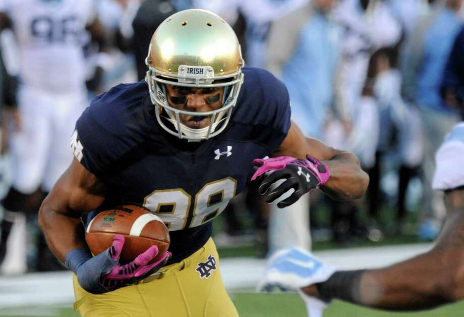 Notre Dame wide receiver Corey Robinson makes a catch against North Carolina in South Bend, Ind., on Oct. 11, 2014. Robinson has decided to walk away from football because of the lingering effects of a concussion. Photo: Joe Raymond /Associated Press / AP