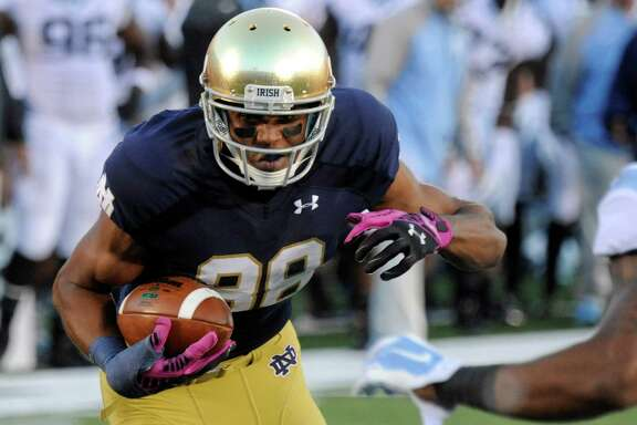 Notre Dame wide receiver Corey Robinson makes a catch against North Carolina in South Bend, Ind., on Oct. 11, 2014. Robinson has decided to walk away from football because of the lingering effects of a concussion.