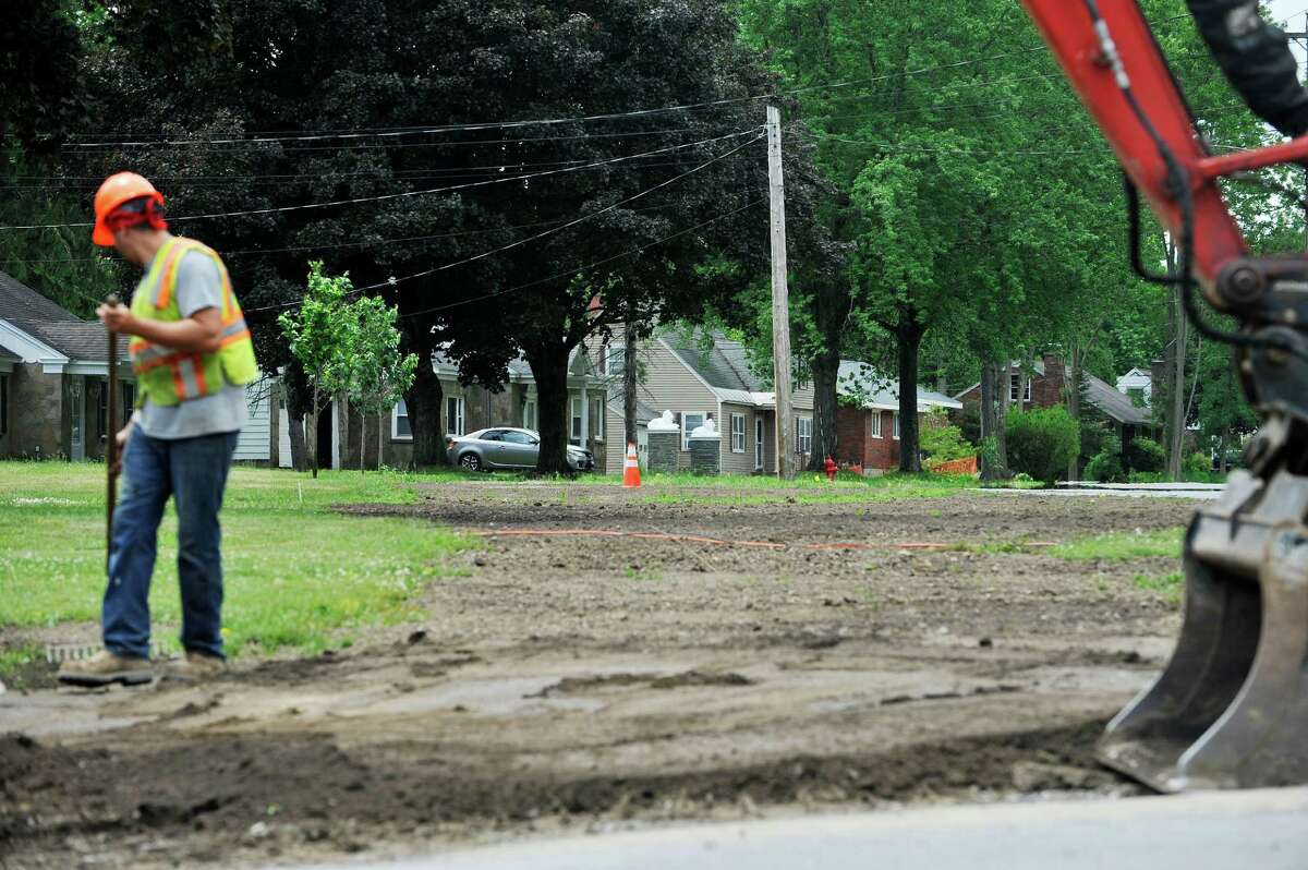 Crews work on various stages of connecting homes in the Sunnyside Gardens housing development to the town waterline on Wednesday, June 8, 2016, in Glenville, N.Y. Homeowner's wells were threatened with contamination from dry cleaning chemicals. (Paul Buckowski / Times Union)