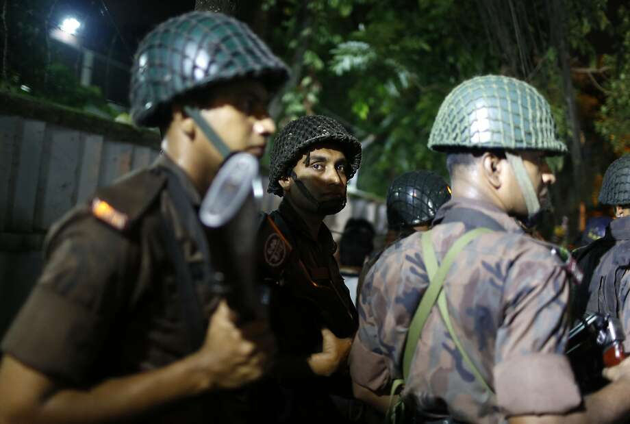 Security forces stand guard near a restaurant frequented by both locals and foreigners in a diplomatic zone in Dhaka. Photo: Associated Press