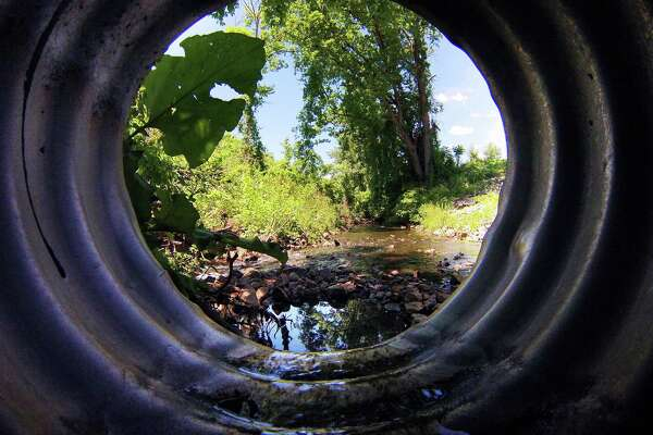 A view from inside a drainage pipe that dumps into a Patroon Creek tributary behind the former Mereco manufacturing plant on Railroad Avenue, seen here on Wednesday, June 15, 2016, in Albany, N.Y.   (Paul Buckowski / Times Union)