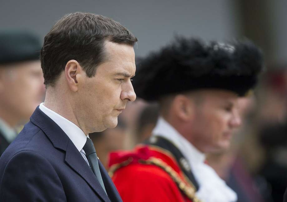 Britain's Chancellor of the Exchequer George Osborne prepares to lay a wealth at the Cenotaph in St Peter's Square, Manchester, England, where a commemoration is being held to mark the 100th anniversary of the start of the World War I battle of the Somme Friday July 1, 2016. Uncertainty about the country's future ties with the EU is weighing heavily on the British economy, prompting Treasury chief George Osborne to announce he was abandoning the government's long-held goal of achieving a budget surplus by 2020. (Danny Lawson/PA via AP) Photo: Danny Lawson, Associated Press